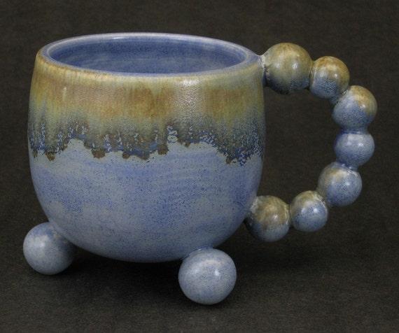 mottled rust and blue tripod mug