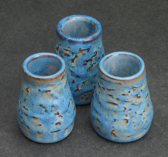 set of three blue shot glasses