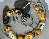 Bone and Wood Skulls Bracelet With Rose Clasp