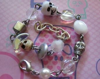 White Skulls and White Beads Charm Bracelet