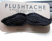 PLUSHTACHE-- Black