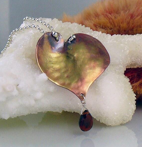 Valentine, bleeding.  Copper heart pendant with garnet