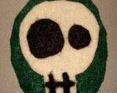 Skull on Dark Green Oval