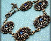 Romance Garden: antiqued brass medallion bracelet with vintage bermuda blue swarovski crystals
