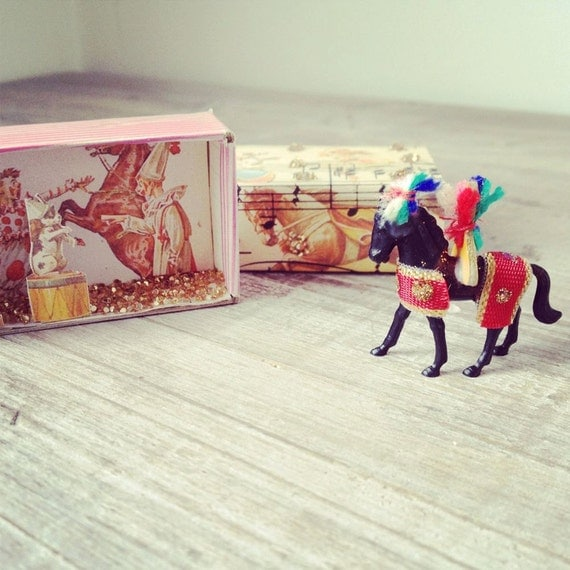 Altered vintage matchbox with a travelling circus inside