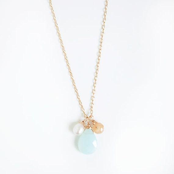 leslie necklace   .  pearl .  blue quartz . orange