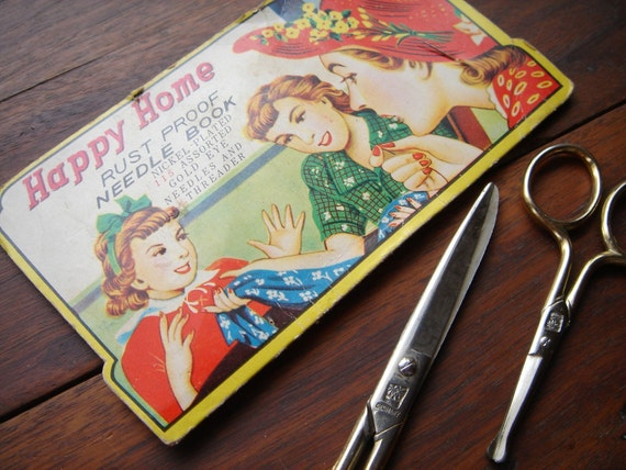 Vintage sewing scissors and needle book