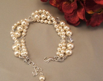 Ivory Wedding Gown Bracelet, Wedding Bracelet,  Cream Swarovski Pearls and Clear Swarovski Crystal, Intertwined Bracelet