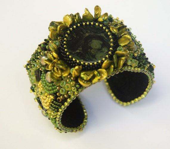 Items similar to born on the bayou bead embroidery cuff