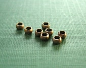 vintaj brass 4 pieces of 4mm circle spacer bead or crimp cover