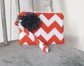 New Orange Chevron Wristlets accented with navy flower Ready to ship cell phone, iphone, camera gadget bag