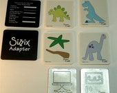 Provo Craft dies-  Dinosaurs and Birthday Cake (includes Sizzix adapters)