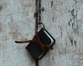 Blackened, worn leather journal necklace