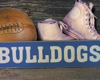 Bulldogs sign football basketball