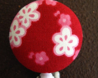 Clip On Retractable Badge Reel / Lanyard with Fabric Covered Button - Pink and White Flowers on Red Background