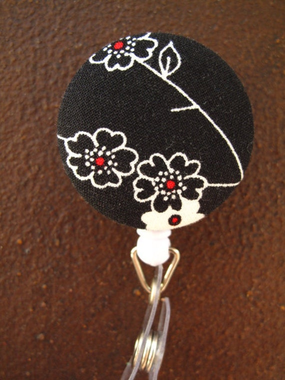 Clip on Retractable Badge Reel with Fabric Covered Button - Black, White and Red Flowers on Black Background