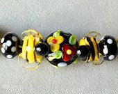 Buzzing around the Garden, bumble bee, bee hive, flowers, garden glass...handmade lampwork glass beads by Marianna