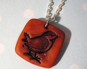 Rustic orange bird pendant