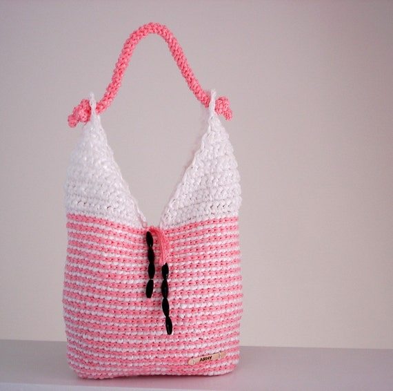 White and Pink eco-friendly handbag made from plarn with one inside pocket and closure