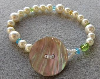 Pearl Girl bracelet with Swarovski pearls, Czech glass and a handmade shell button clasp