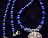 Graduated Lapis necklace with Ganesha talisman