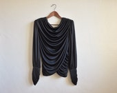 reserved for tracy alexandria. please do not purchase.  black draped reconstructed jersey blouse / top / strong shoulder / s / m