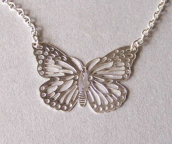 Silver butterfly necklace.