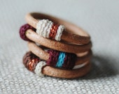 Set of four leather and cotton rings