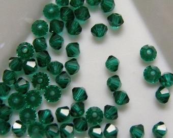 24pc Swarovski  5301 4mm Emerald