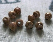 Bone Skull beads - 8mm-10mm - 10 bone center drilled beads - tan, brown, black, caramel - bead supplies