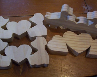 4-Unfinished wood shapes of a boy, girl , ducks, hearts