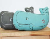 hand embroidered whale pillow in light teal