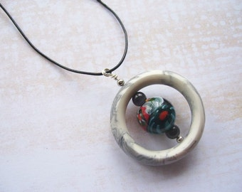 Gray Marbled Resin Ring Necklace With Beaded Center