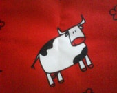 Cow in a red background fabric