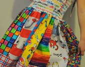 Who doesn't LOVE Dr. Seuss ---  Here is the perfect toddler/girl twirl shirred panel sundress for any Dr. Seuss fan - 2T-6Y