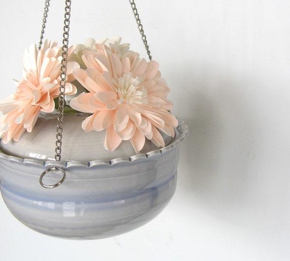 Hanging ikebana vase in baby blue.