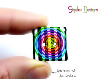 2 Handmade polymer clay buttons with stripes and psychedelic spiral