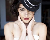BLACK VEILED MINI TOP HAT WITH BLACK/WHITE RIBBONING AND STUNNING OSTRICH FEATHERS