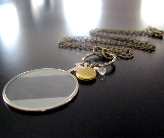 vintage optical lens necklace with locket and pale aquamarine