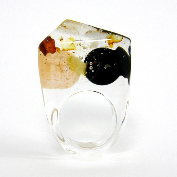 Clear resin ring with amber, gold and black resin