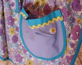 Turquoise and purple daisy apron
