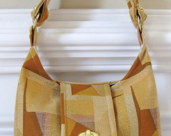 Gold and Rust Geometric Print Hobo Bag with Flap and Turn Lock Closure