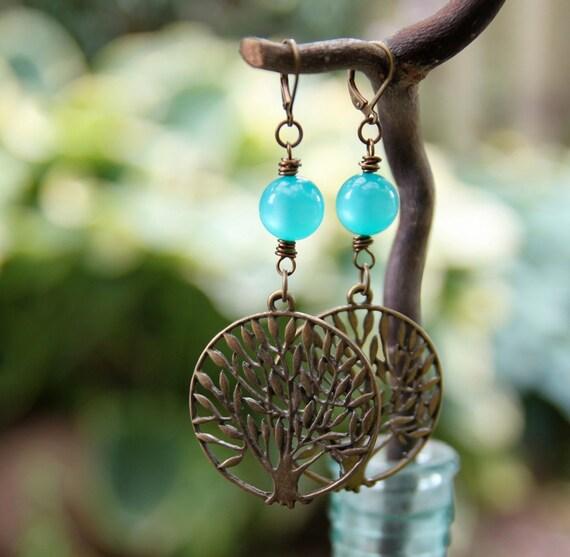 rooted earrings . deep aqua