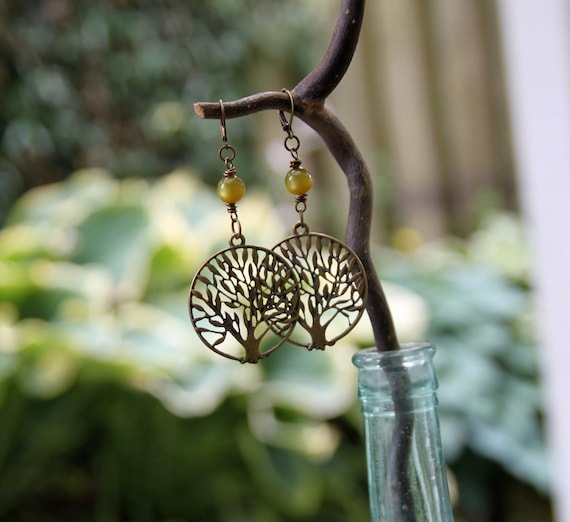 rooted earrings . olivine green