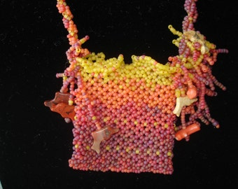 Caught in the Coral Netted Amulet Bag