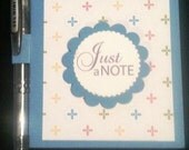 Post-It note pad and pen
