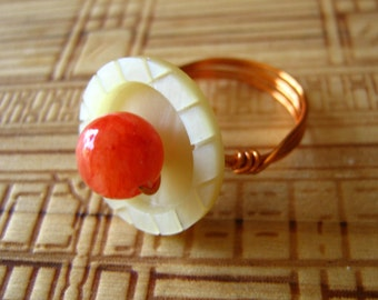 Button blossom with Orange Jade wired ring