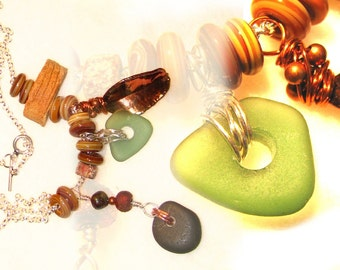Necklace, mixed media, metals, beach stone, beach glass, lampwork, pitfired and raku beads. Element, by melanie j cook.