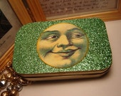 man in the moon face green glitter keeper  tin box with tags inside