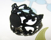 10 black adjustable filigree ring bases with an 8mm glue on pad  (lead and nickel free)